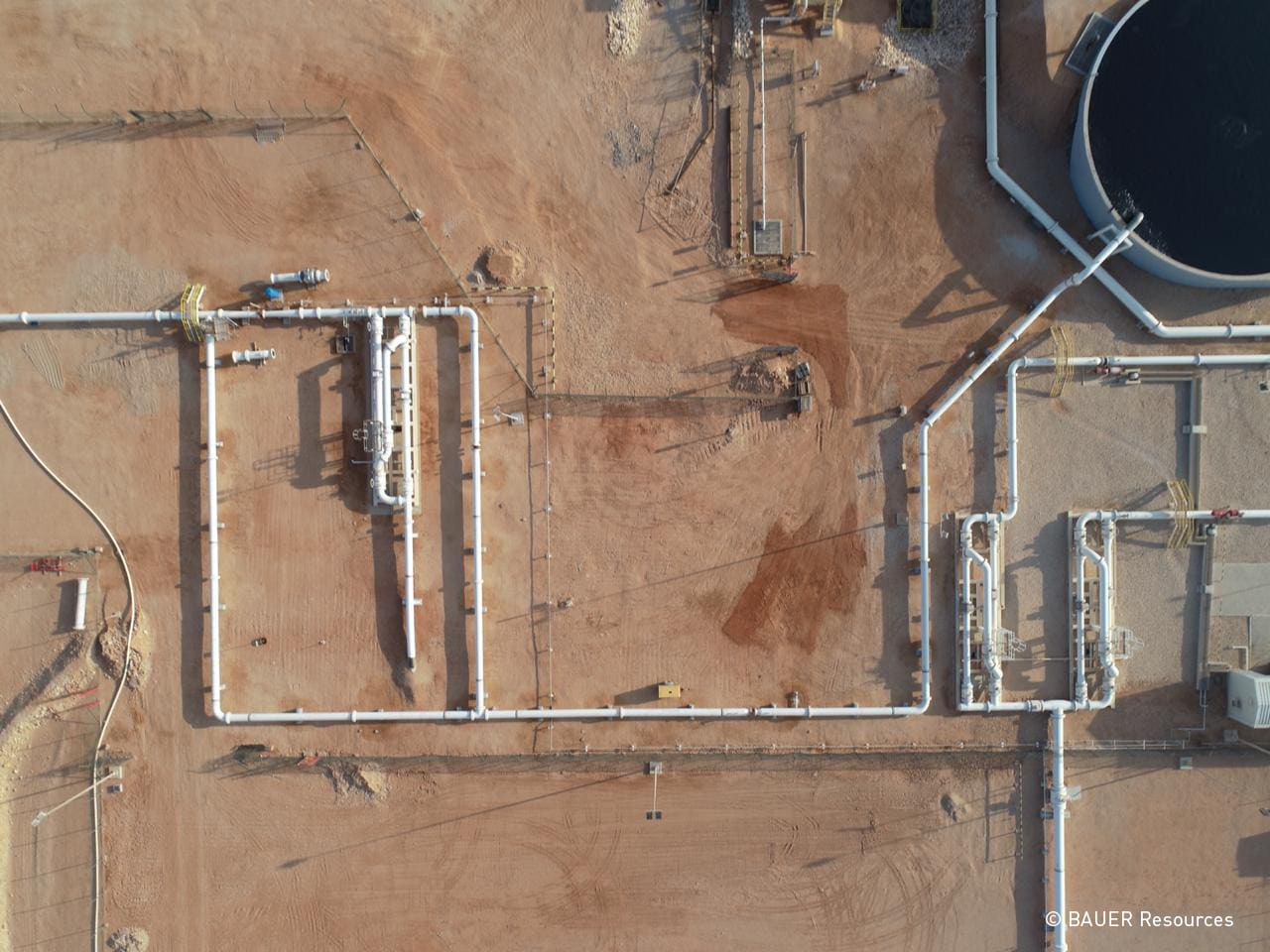 Wastewater treatment plant with water skids from above